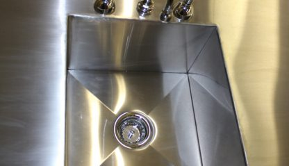 SurgiKleen® Stainless Steel Free Standing Sink Table showing sink interior and drain