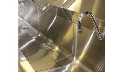 SurgiKleen stainless steel floor mounted medical scrub sink view of interior detail with splash guard