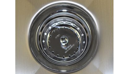 SurgiKleen stainless steel wall mounted medical scrub sink with 3 bays close-up of installed sink drain