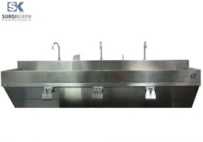 SurgiKleen® Stainless Steel Wall-Mounted 3 Bay Surgical Scrub Sink with 3 sinks shown with knee pedal controls from front view and SurgiKleen logo