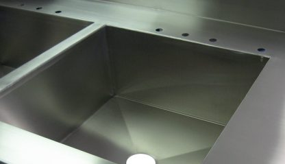 SurgiKleen® Stainless Steel Laboratory Sink Table with 3 sinks showing sink detail with plumbing cutouts