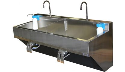 SurgiKleen® Stainless Steel Dual Bay Wall Mount Scrub Sink showing installation with optional soap dispensers